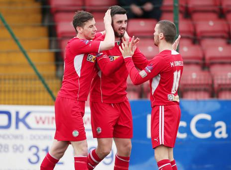 Stat's magic: Eamonn Seydak and Martin Donnelly congratulate Joe Gormley after his record-breaking 38th goal of the season