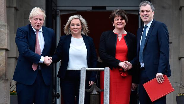 BELFAST, NORTHERN IRELAND - JANUARY 13: Prime Minister Boris Johnson (L) and Secretary of State for Northern Ireland, Julian Smith (R) are greeted by First Minister, Arlene Foster of the DUP (2nd R) and Deputy First Minister Michelle O'Neill (2nd L) of Sinn Fein at Stormont on January 13, 2020 in Belfast, Northern Ireland. (Photo by Charles McQuillan/Getty Images)