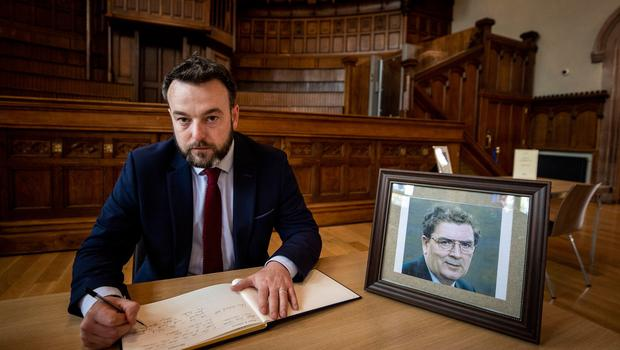 Leader of the SDLP Colum Eastwood, signing the book of condolence at Guildhall in Derry City to his former leader John Hume. The Former SDLP leader, who was one of the key architects of peace in Northern Ireland, has died at the age of 83. PA Photo. Picture date: Monday August 03, 2020. See PA story DEATH Hume. Photo credit should read: Liam McBurney/PA Wire
