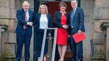 (FILES) In this file photo taken on January 13, 2020 Britain's Prime Minister Boris Johnson (L) and Britain's Northern Ireland Secretary Julian Smith (R) arrive to meet with Northern Ireland's First Minister Arlene Foster (2R) and Deputy First Minister Michelle O'Neill (2L) on the steps of Stormont Castle on the Stormont Estate in Belfast on January 13, 2020. - British Prime Minister Boris Johnson began a post-Brexit shake-up of his top team February 13, 2020 by sacking his Northern Ireland minister, despite his role in restoring devolved government to Belfast. Julian Smith was a surprise casualty of the Conservative leader's first cabinet reshuffle since his victory in December's general election and after Britain left the European Union on January 31. (Photo by PAUL FAITH / AFP) (Photo by PAUL FAITH/AFP via Getty Images)