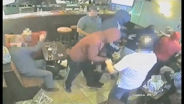 CCTV footage shows the gang attack Mr Moore.