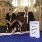 Pacemaker Press Belfast 20-06-2017: Opening of Book of Condolence from victims of Grenfell Tower fire Belfast Lord Mayor Nuala McAllister (right) Deputy Lord Mayor Sonia Copeland and Belfast High Sheriff Alderman Tom Haire. Other Councillors also joined to sign the book this lunchtime Picture By: Arthur Allison.