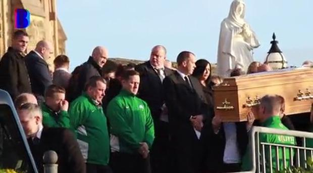 Mourners at the funeral of former Cliftonville goalkeeper Paul Straney