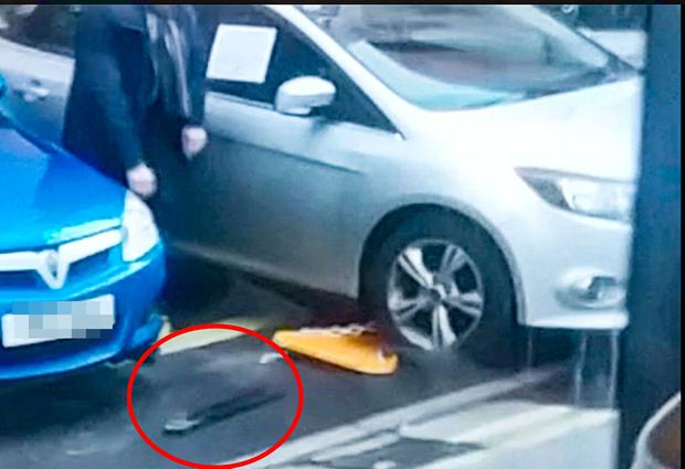 Gerry Kelly used bolt cutters on a clamped car close to the MAC in Belfast on February 2 2018 (Photo by Belfast Telegraph)