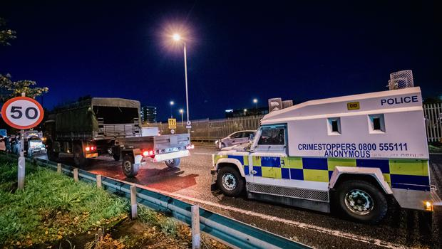 Police guard an army transport convoy that broke down on the Westlink on October 19, 2021 (Photo by Kevin Scott for Belfast Telegraph)