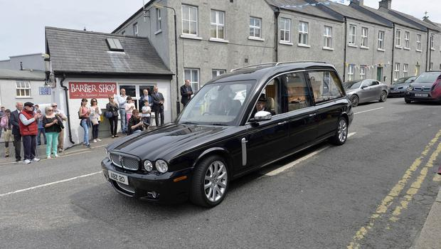 10th August 2020 -  Funeral of past UTV Presenter Brian Black as it passes through his home town of Strangford on its way to  Roselawn cemetery in Belfast.  Brian  tragically died last week when his car entered the water at the harbour in Strangford .tPhoto by Stephen Hamilton/Presseye