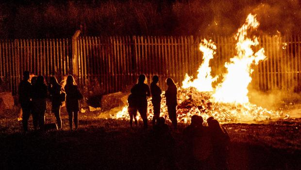 A bonfire is lit in the Distillery Street area of west Belfast where 26 officers were injured on August 8th 2020 (Photo by Kevin Scott for Belfast Telegraph)