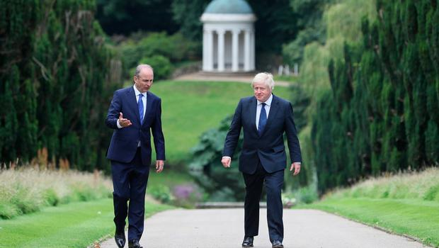 Prime Minister Boris Johnson (right) and Taoiseach Micheal Martin walking in the gardens of Hillsborough Castle during the Prime Minister's visit to Belfast. PA Photo. Picture date: Thursday August 13, 2020. See PA story ULSTER Johnson. Photo credit should read: Brian Lawless/PA Wire